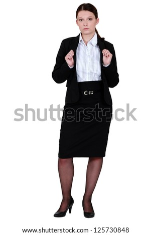 Young woman wearing black suit - stock photo