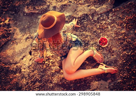 young woman wearing boho style clothes enjoy in summer day on the beach, retro colors - stock photo