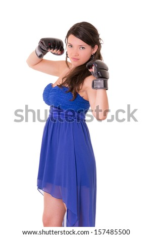Young woman wearing boxing gloves in casual dress - stock photo