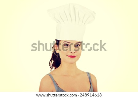 Young woman wearing chef hat. - stock photo