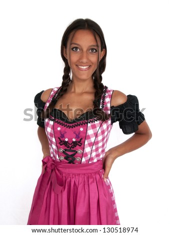 Young woman wearing dirndl smiling on white background