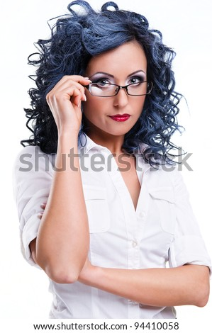 Young woman wearing glasses posing over white background