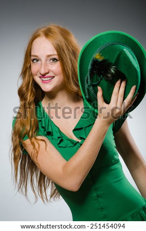 Young woman wearing green dress - stock photo