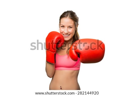 Young woman wearing gym clothes. She has boxing gloves - stock photo