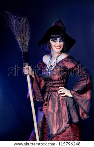 young woman wearing halloween witch costume - stock photo