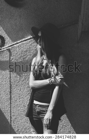 young woman wearing hat  - stock photo