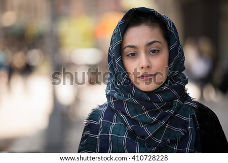 Young woman wearing hijab head scarf in city smile happy face portrait