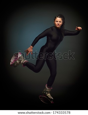 young woman wearing kangoo jumps boots - stock photo