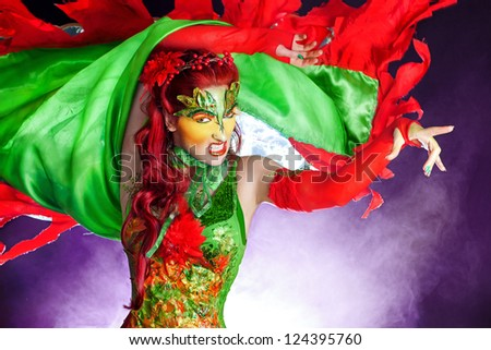 Young woman wearing Poison Ivy costume, face paint/Sexy Poison Ivy - stock photo