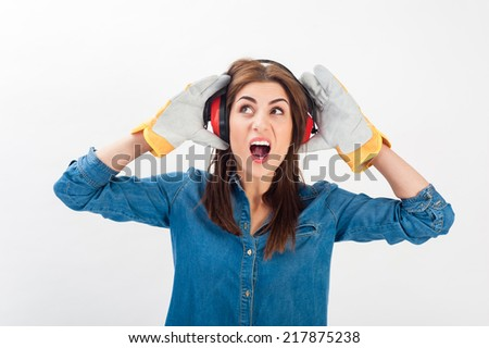 Young woman wearing protective gear looking sideways with a screaming face. Isolated over white in horizontal format. - stock photo