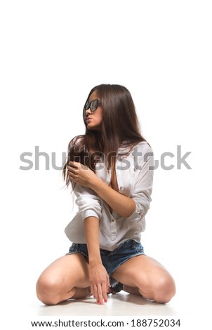 Young woman wearing sexy clothes. Isolated over white background. - stock photo