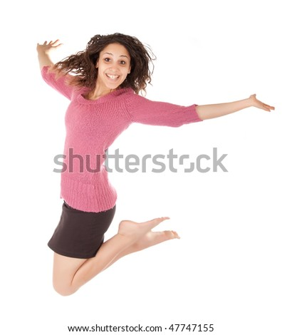 young woman wearing skirt jumping isolated on white