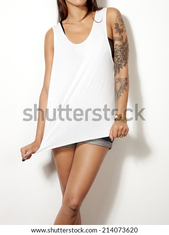 Young woman wearing sleeveless t-shirt - stock photo