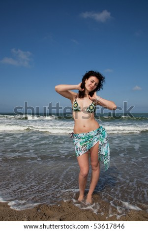 young woman wearing swimsuit at the seaside - stock photo