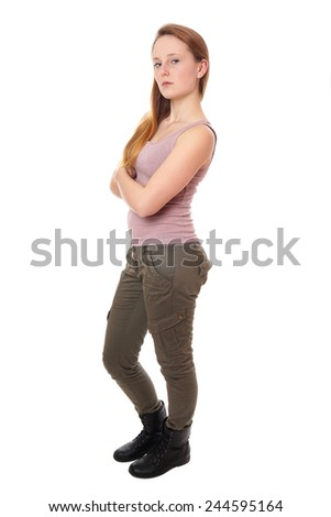 young woman wearing tank top, military style khaki pants and boots - stock photo