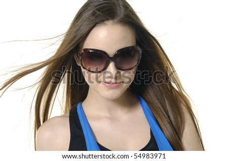 Young woman wearing the modern sunglasses.