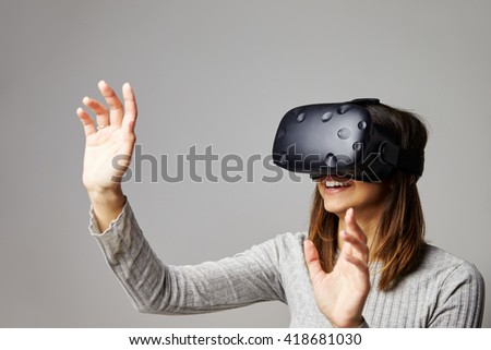 Young Woman Wearing Virtual Reality Headset In Studio