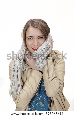 young woman wearing warm winter clothes and hiding from the cold - stock photo