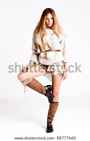 young woman wearing winter clothes, full body shot, studio shot