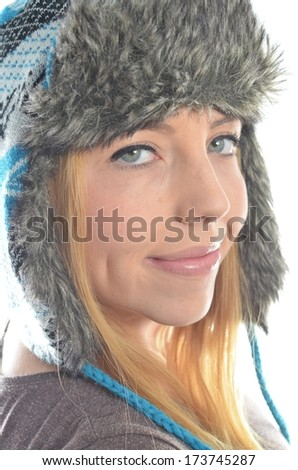 Young woman wearing winter clothing isolated
