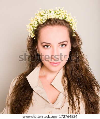 young woman wearing wreath of flowers - stock photo