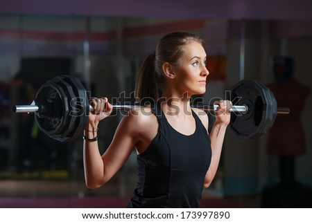 Young woman weight training - stock photo