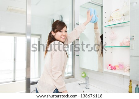 young woman who cleans the restroom