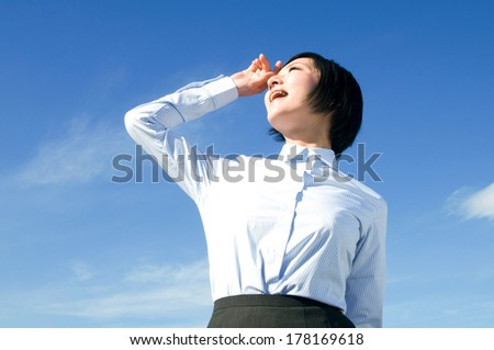 Young woman who made the blue sky the background