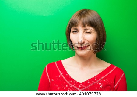 young woman winking - stock photo