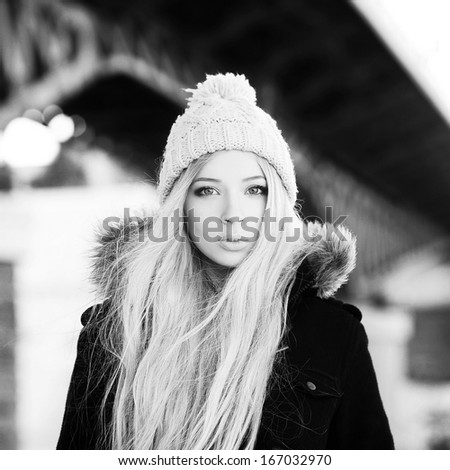 Young woman winter outdoors close-up portrait. the black and white photo - stock photo