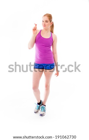 Young woman wishing with crossing fingers - stock photo