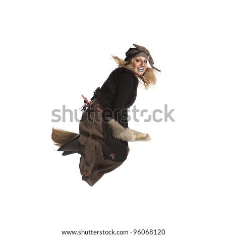 Young woman witch fly on broom. Isolated. - stock photo
