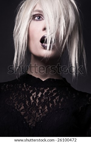 Young woman-witch in a vampire look - stock photo