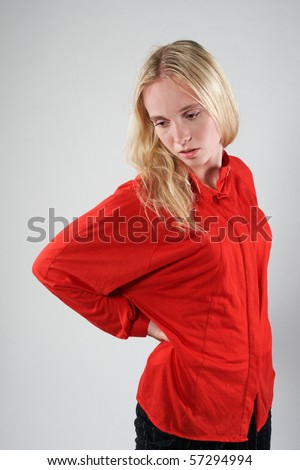 young woman with a back pain - stock photo