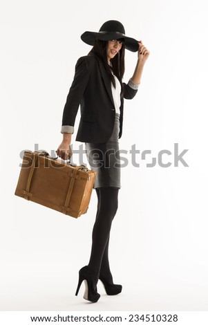 young woman with a bag dressed in black isolated on white background