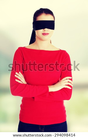 Young woman with a band on eyes - stock photo