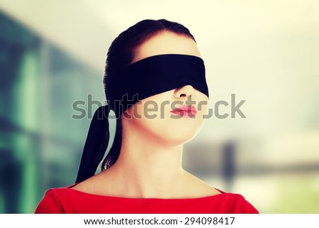 Young woman with a band on eyes