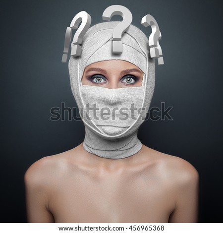 young woman with a bandaged face, and questions over his head - stock photo
