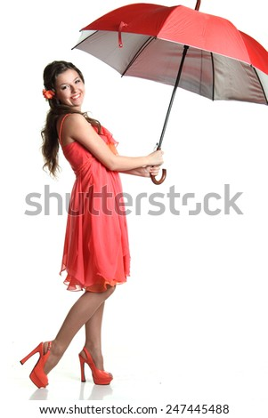 young woman with a beautiful figure. with umbrella. with dance moves - stock photo