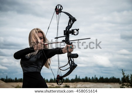 Young woman with a compound bow
