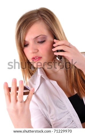 Young woman with a credit card speaking on phone