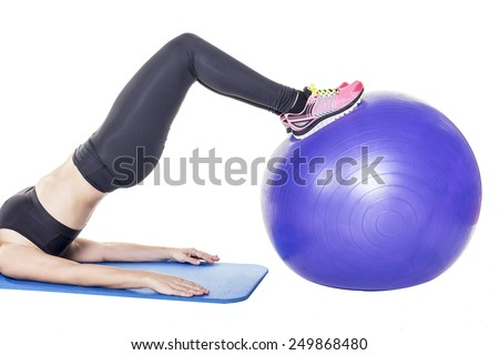 young woman with a fitness ball working her muscles