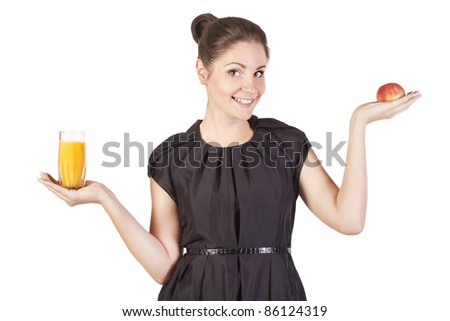 Young woman with a glass of juice and apple