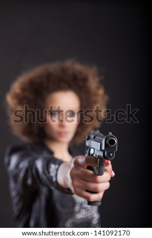 Young woman with a gun.