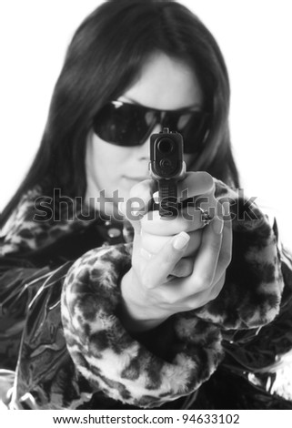 young woman with a gun isolated on white