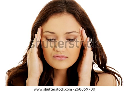 Young woman with a headache holding her head,. - stock photo