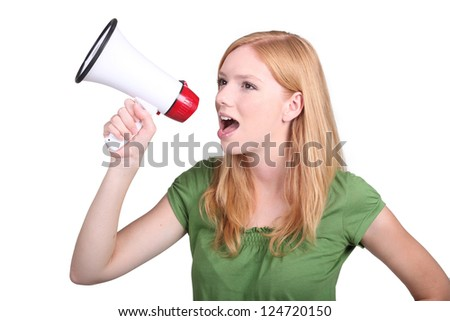 Young woman with a loudspeaker - stock photo