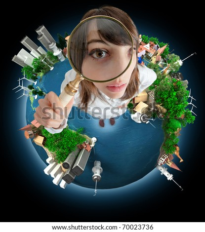 Young woman with a magnifying glass standing on the Earth - stock photo