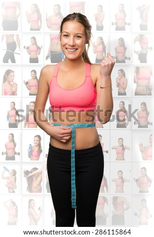 Young woman with a measurement scale in her belly - stock photo