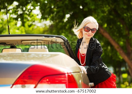 Young woman with a new car. - stock photo
